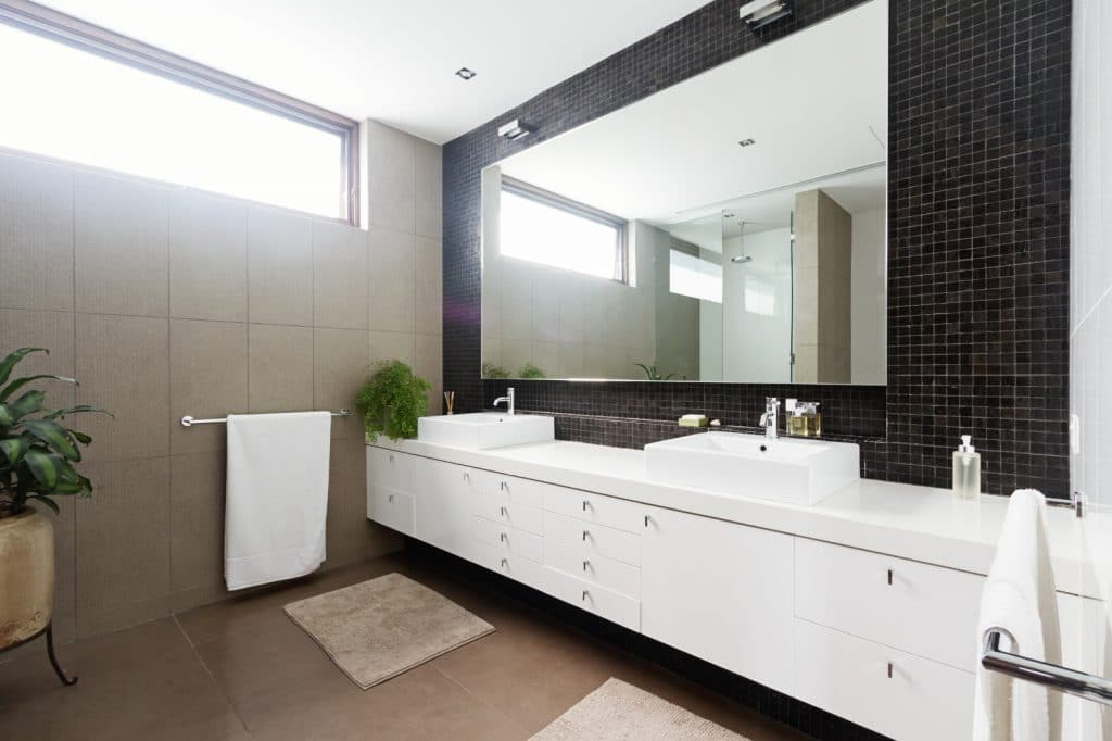 New Elegant Bathroom White Sink Cabinets Black Micro Square Mosaic Tile | Best General Contractor for Bathrooms in Los Angeles | High Class Builders