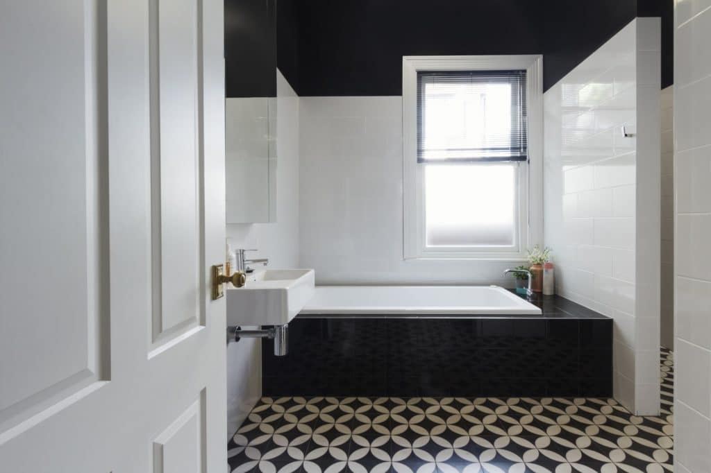 New Elegant Guest Bathroom Black and White Sink and Bathtub | Best General Contractor for Bathrooms in Los Angeles | High Class Builders