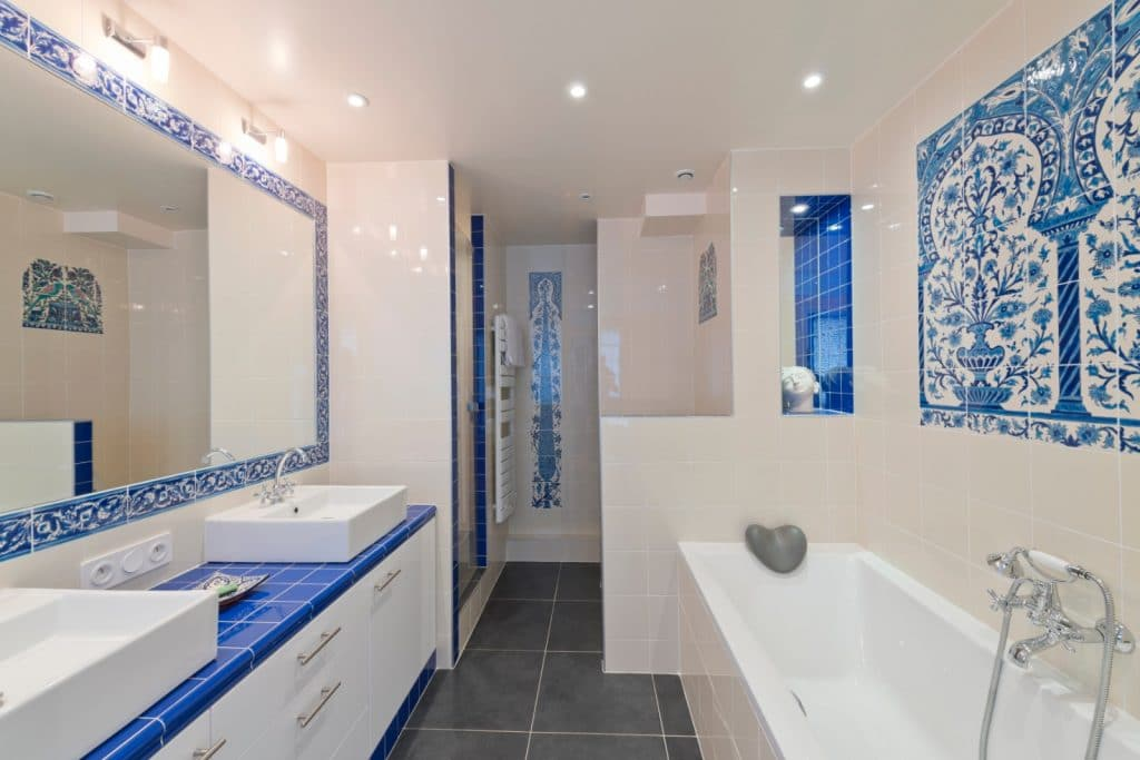Remodeled Greek Style Bathroom Blue White Sink Cabinets with Grey Tile Floor | Best General Contractor for Bathrooms in Los Angeles | High Class Builders