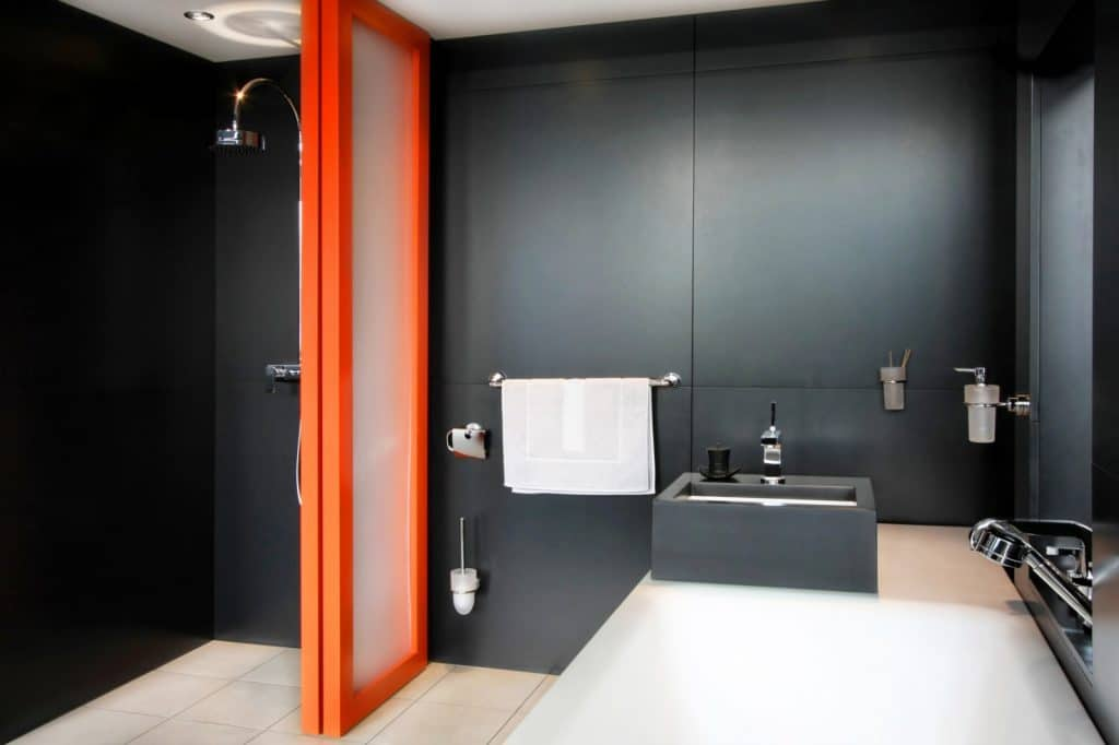 New Modern Bathroom Red Door Shower Black Stone Wall and Sink | Best General Contractor for Bathrooms in Los Angeles | High Class Builders