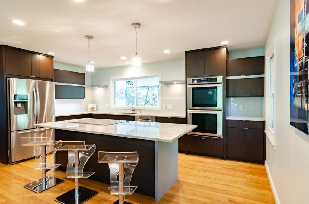 Remodeled Kitchen White Granite Countertops Brown Wood Cabinets | Best General Contractor for Kitchens in Los Angeles | High Class Builders
