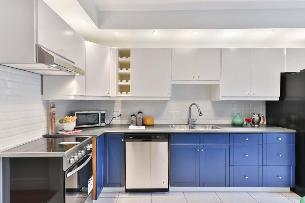 Simple Remodeled Kitchen Blue Counter Cabinets White Cabinets | Best General Contractor for Kitchens in Los Angeles | High Class Builders