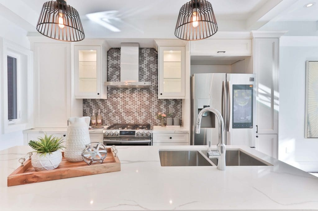 Simple Remodeled Kitchen White Counter White Glass Cabinets | Best General Contractor for Kitchens in Los Angeles | High Class Builders