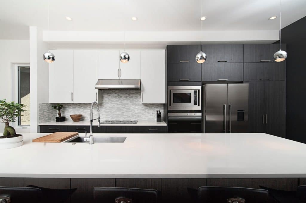 Remodeled Minimalist Kitchen White Counter Table Black Wood Cabinets | Best General Contractor for Kitchens in Los Angeles | High Class Builders