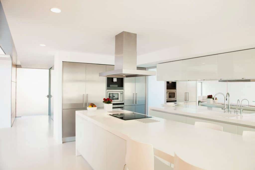 Modern High End Minimalist Kitchen Waterfall White Counter Cabinets Long Table | Best General Contractor for Kitchens in Los Angeles | High Class Builders