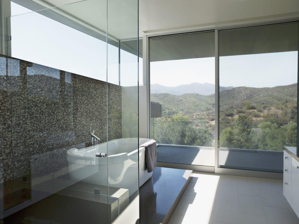 Modern Bathroom Glass Shower Bathtub Light Floor Dark Marble Wall | Best General Contractor for Bathrooms in Los Angeles | High Class Builders