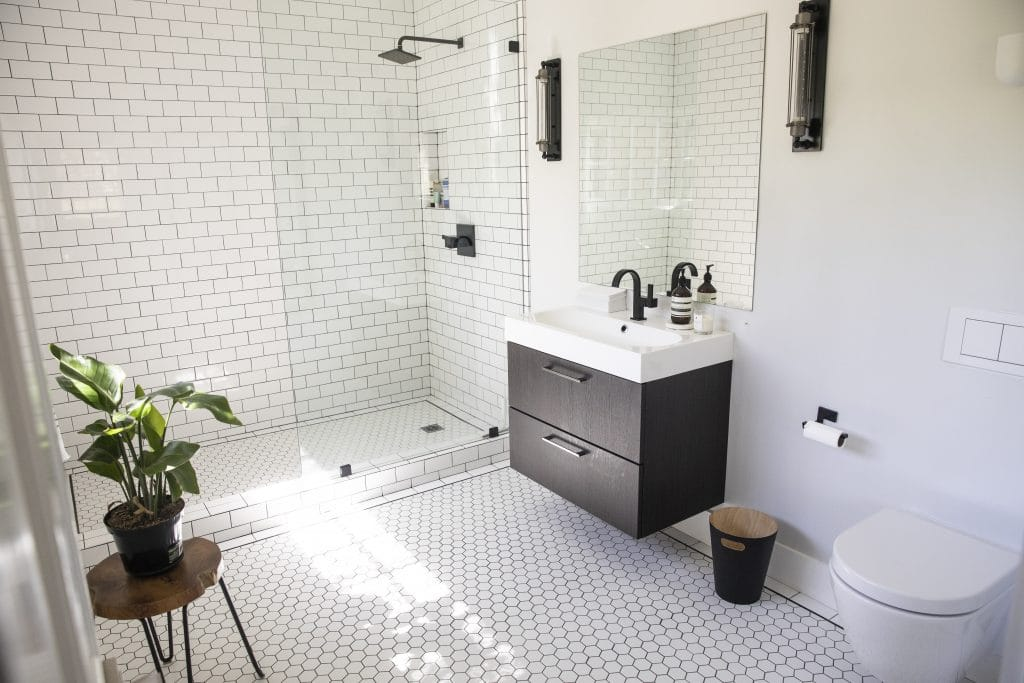 Modern Bathroom White Tile Glass Shower Dark Wood Cabinets | Best General Contractor for Bathrooms in Los Angeles | High Class Builders