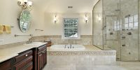 Master bath in new construction home with large glass shower