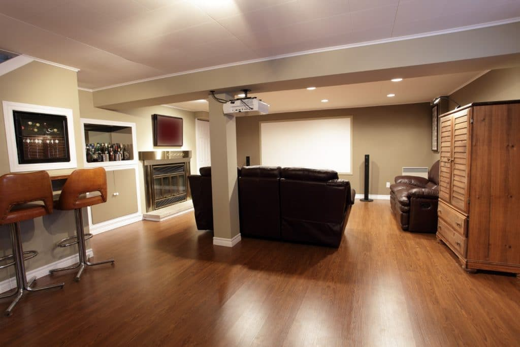 Remodeled Home Entertainment Theatre Room Construction with Leather Couch and Bar Lounge Man Cave | Best General Contractor for Home Entertainment Systems in Los Angeles | High Class Builders