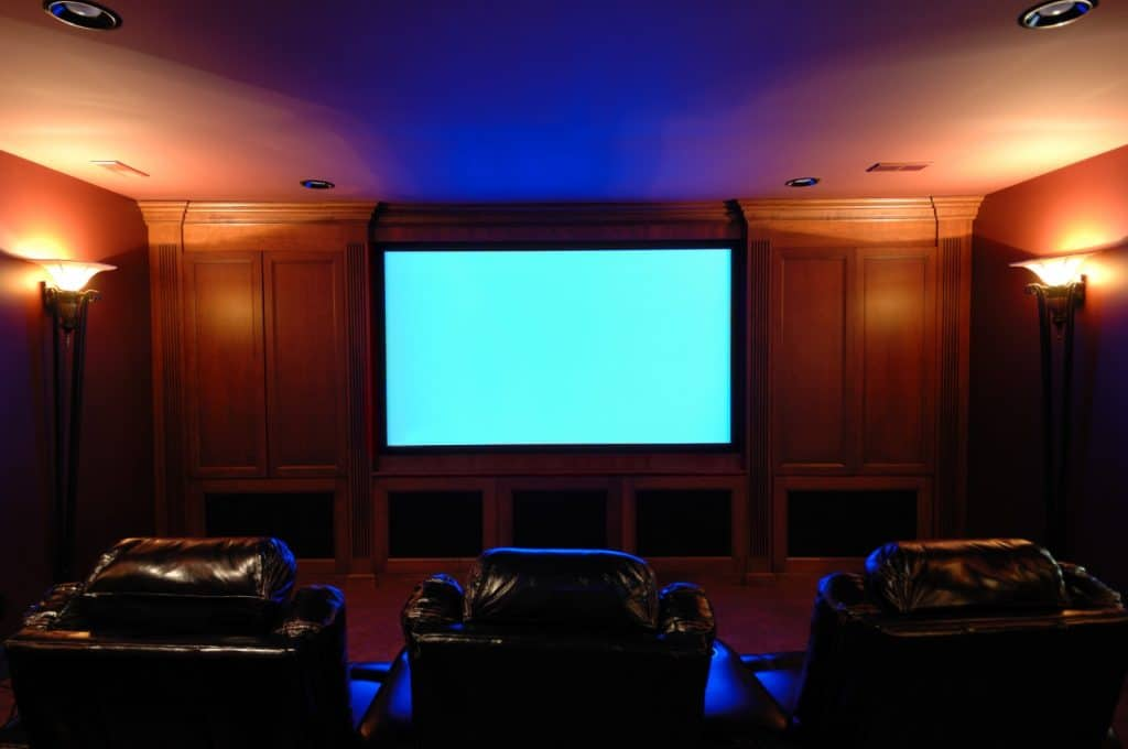 New Home Entertainment Theatre Room Construction with Leather Cinema Seats and Ambient Lighting | Best General Contractor for Home Entertainment Systems in Los Angeles | High Class Builders