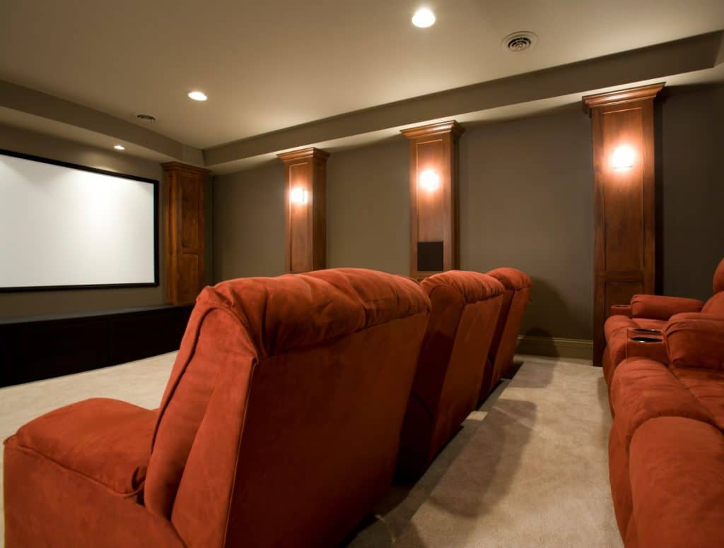 New Home Entertainment Theatre Room Construction with Red Cinema Seats and Lighting | Best General Contractor for Home Entertainment Systems in Los Angeles | High Class Builders