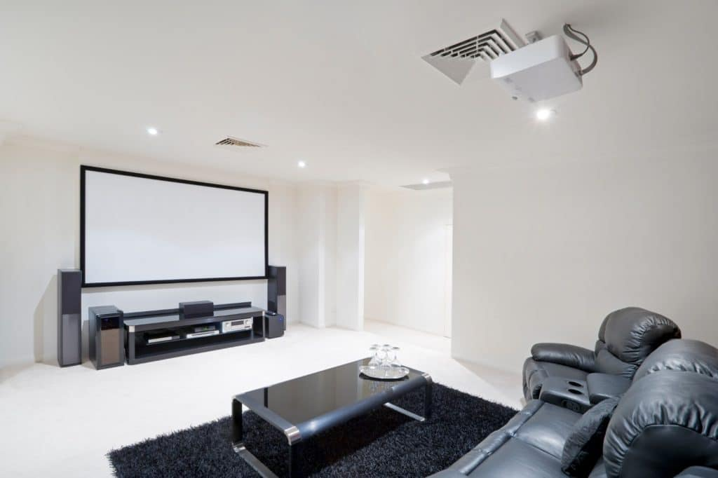 New Home Entertainment Theatre Room Construction with Leather Cinema Seats black and white | Best General Contractor for Home Entertainment Systems in Los Angeles | High Class Builders