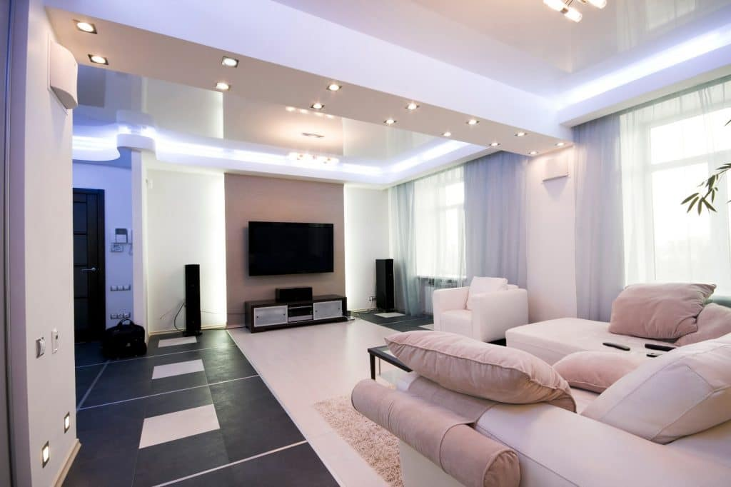 New Modern Home Entertainment Theatre Room Construction with Beige Couches and LED Lighting | Best General Contractor for Home Entertainment Systems in Los Angeles | High Class Builders