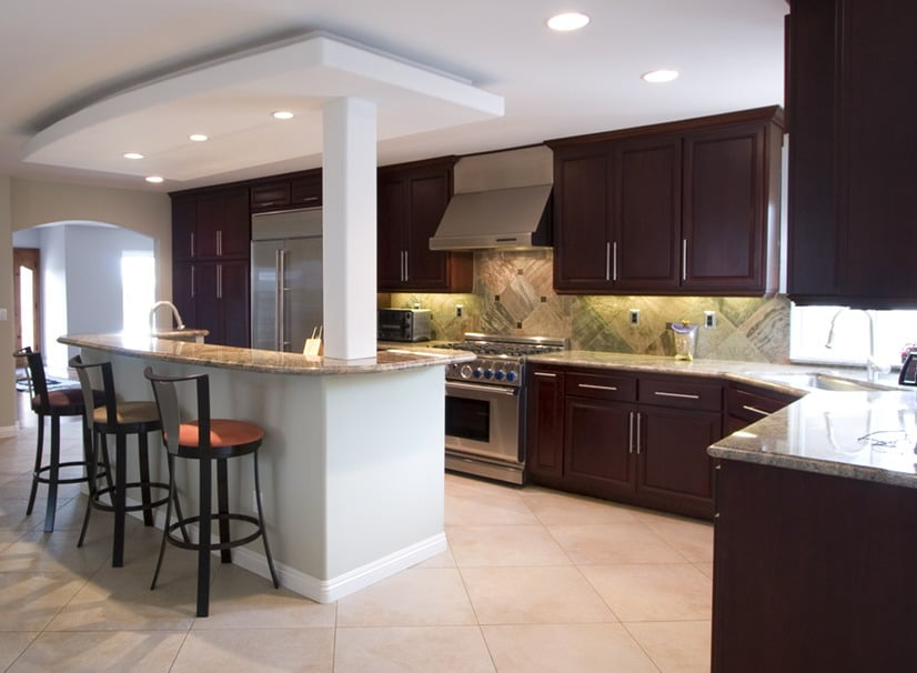 Remodeled Kitchen Granite Countertops Dark Brown Wood Cabinets Black Stools | Best General Contractor for Kitchens in Los Angeles | High Class Builders