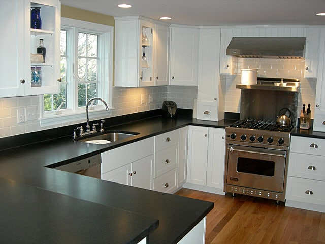Remodeled Simple Kitchen Black Countertops White Wood Cabinets | Best General Contractor for Kitchens in Los Angeles | High Class Builders
