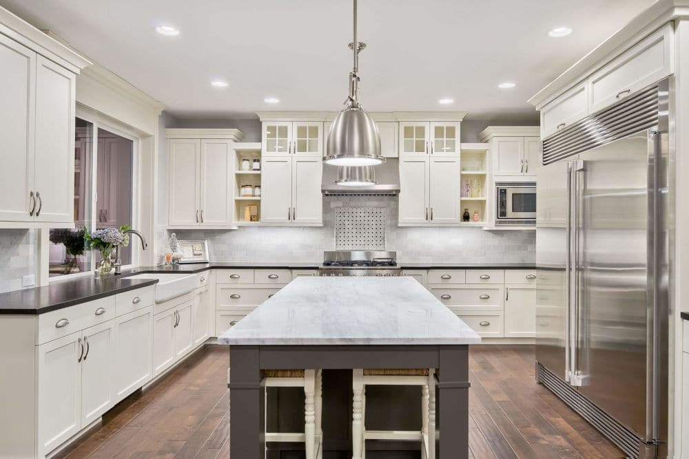 New Open Kitchen White Granite Countertop White Wood Cabinets | Best General Contractor for Kitchens in Los Angeles | High Class Builders