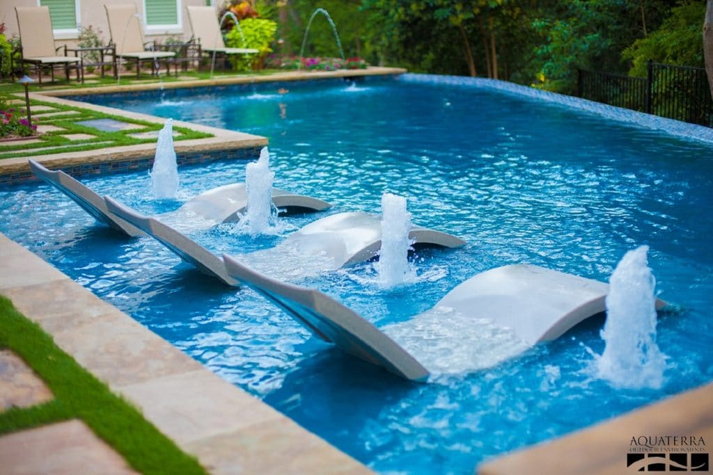 New Backyard Infinity Pool with Fountains and In-Pool Ledge Lounger Deep Chaise | Best General Contractor for Pools in Los Angeles | High Class Builders