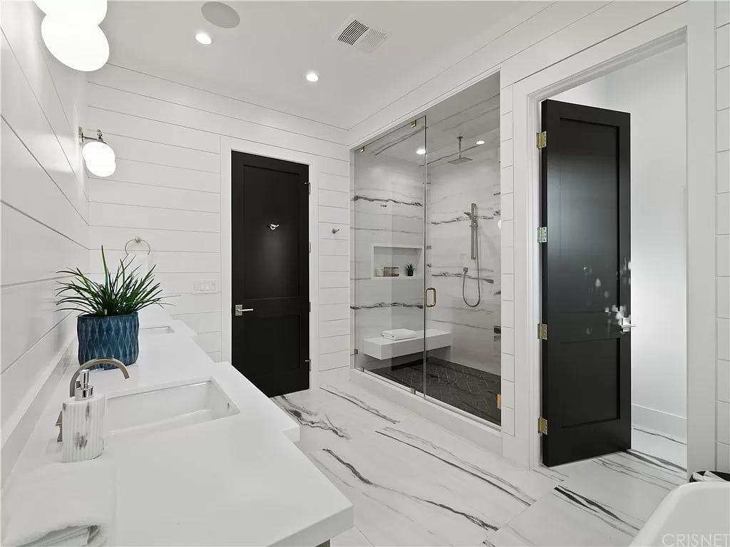 Modern Bathroom white marble White countertop black doors | Best General Contractor for Bathrooms in San Francisco | High Class Builders