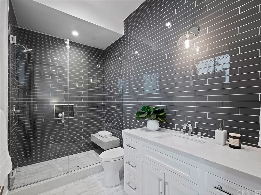 Modern Bathroom grey tile White countertop | Best General Contractor for Bathrooms in Los Angeles | High Class Builders