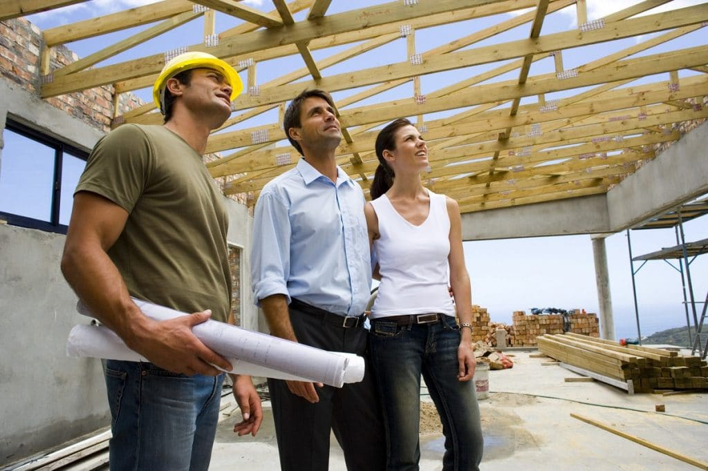 Renovation vs. Remodeling Contractor Adult Couple with Contractor on Construction Site   Best General Contractor in Los Angeles   High Class Builders Blog